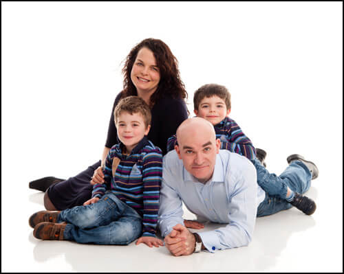 Family of four, portrait on high key, white background