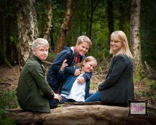 Family portrait in the woods by photographer Phill Andrew at The Image Mill