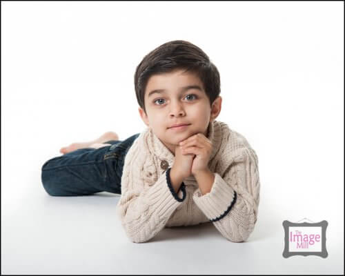 Young boy on floor looking at camera